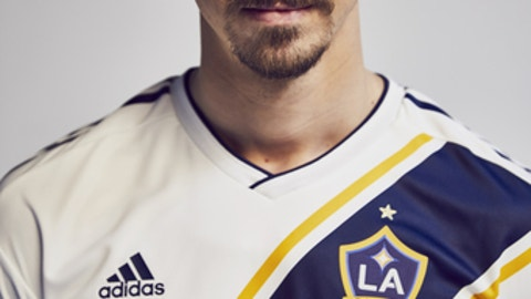 In this photo provided Friday, March 23, 2018, by the LA Galaxy, forward Zlatan Ibrahimovic, of Sweden, poses in the uniform of his new club. The 36-year-old forward comes to the MLS soccer club from Manchester United, where he played for two seasons. He made 53 appearances with the club, scoring 29 goals. (Jon Shard/LA Galaxy via AP)