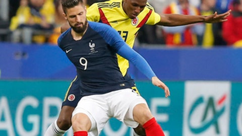 France's Olivier Giroud, front, and Colombia's Yerry Mina challenge for the ball during a friendly soccer match between France and Colombia in Saint-Denis, outside Paris, Friday March 23, 2018. (AP Photo/Michel Euler)