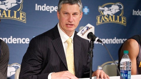 "FILE - In this Jan. 9, 2016, file photo, La Salle's head basketball coach Dr. John Giannini takes questions from the media following the second half an NCAA basketball game against Dayton in Philadelphia. La Salle split with Giannini on Friday, March 23, 2018, following a 13-19 finish in his 14th season. The school said in a statement the Explorers and the coach have ""mutually agreed to part ways,"" and a search for a new coach has begun. (AP Photo/Chris Szagola, File)"