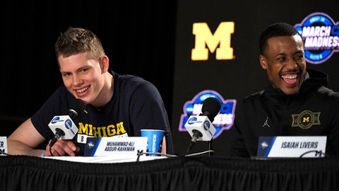Michigan forward Moritz Wagner, left, speaks as guard Muhammad-Ali Abdur-Rahkman laughs during a news conference at the NCAA men's college basketball tournament Friday, March 23, 2018, in Los Angeles. Michigan faces Florida State in a regional final Saturday. (AP Photo/Mark J. Terrill)