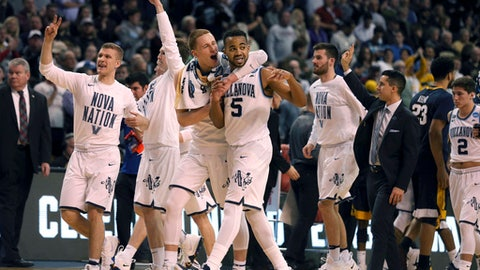 Villanova celebrates a 90-78 win over West Virginia in an NCAA men's college basketball tournament regional semifinal Friday, March 23, 2018, in Boston. (AP Photo/Mary Schwalm)