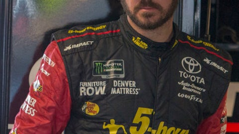 Martin Truex Jr. stands in the garage during practice for the NASCAR Cup Series auto race at Martinsville Speedway in Martinsville, Va., Saturday, March 24, 2018. (AP Photo/Matt Bell)