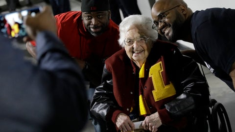 Loyola-Chicago basketball chaplain Sister Jean Dolores Schmidt, poses with fans for a photo before the first half of a regional final NCAA college basketball tournament game, Saturday, March 24, 2018, in Atlanta. (AP Photo/David Goldman)
