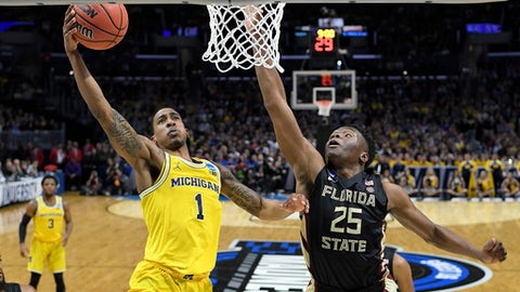 Michigan guard Charles Matthews (1) shoots against Florida State forward Mfiondu Kabengele (25) during the first half of an NCAA men's college basketball tournament regional final Saturday, March 24, 2018, in Los Angeles. (AP Photo/Jae Hong)