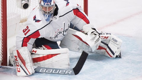Washington Capitals goaltender Philipp Grubauer makes a save against the Montreal Canadiens during the third period of an NHL hockey game in Montreal, Saturday, March 24, 2018. (Graham Hughes/The Canadian Press via AP)
