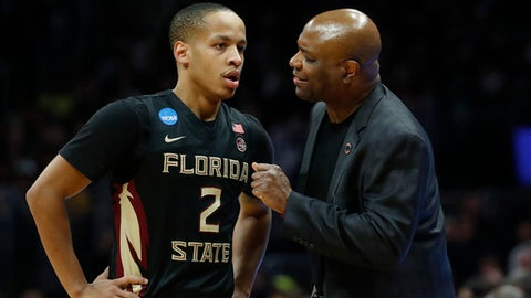 Florida State coach Leonard Hamilton, right, talks with guard CJ Walker (2) during the second half of an NCAA men's college basketball tournament regional final against Michigan on Saturday, March 24, 2018, in Los Angeles. (AP Photo/Jae Hong)