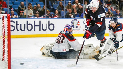 FILE - In this Dec. 28, 2017, file photo, United States' Casey Mittelstadt scores a goal on Slovakia goalie Roman Durny, left, as Michal Ivan, right, defends during the third period of an IIHF world junior hockey championships game in Buffalo, N.Y. The Buffalo Sabres have reached an agreement with their top prospect, center Casey Mittelstadt, who is leaving Minnesota following his freshman season. Mittelstadt agreed to a three-year entry level contract Monday, March 26, 2018, and is expected to join the Sabres as early as Tuesday.(Mark Blinch/The Canadian Press via AP, File)