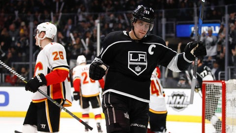 Los Angeles Kings' Anze Kopitar, of Slovenia, celebrates his goal during the second period of an NHL hockey game against the Calgary Flames, Monday, March 26, 2018, in Los Angeles. (AP Photo/Jae C. Hong)