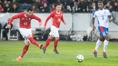 Switzerland's Blerim Dzemaili, left, scores their first goal during an international friendly soccer match between Switzerland and Panama at the Swisspor Arena, in Lucerne, Switzerland, Tuesday, March 27, 2018. (Urs Flueeler/Keystone via AP)