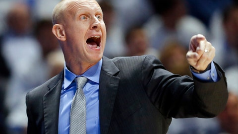 FILE - In this Dec. 2, 2017, file photo, Xavier head coach Chris Mack directs his players during the first half of an NCAA college basketball game against Cincinnati in Cincinnati. According to multiple reports Louisville has hired Xavier's Chris Mack as its new mens basketball coach, hoping he can guide the program back to national contention after a turbulent season in which the Cardinals missed the NCAA Tournament. (AP Photo/John Minchillo, File)