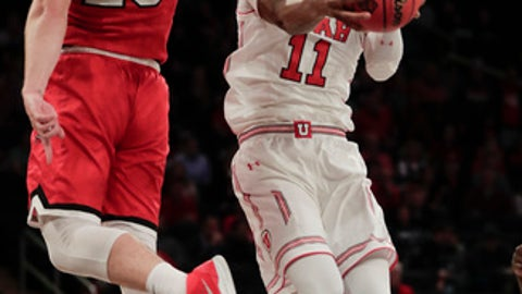 Utah forward Chris Seeley (11) shoots against Western Kentucky forward Justin Johnson (23) during the first half of an NCAA college basketball game during the semifinals of the NIT Tuesday, March 27, 2018, in New York. (AP Photo/Julie Jacobson)