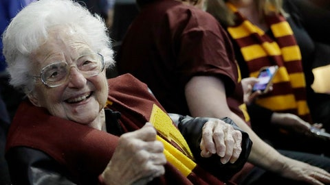 FILE - This March 22, 2018 file photo shows Sister Jean Dolores Schmidt sitting with other Loyola-Chicago fans during the first half of a regional semifinal NCAA college basketball game against Nevada in Atlanta. Sister Jean is depicted in a bobblehead and sales of the figurine have soared to the heavens. She has become a celebrity during the NCAA mens basketball tournament. As a result, the National Bobblehead Hall of Fame and Museum, in conjunction with Loyola University, last week unveiled a limited edition bobblehead. Phil Sklar with the soon-to-be-open museum in Milwaukee says within 24 hours, the bobblehead became the institution's top seller of all time. (AP Photo/David Goldman)