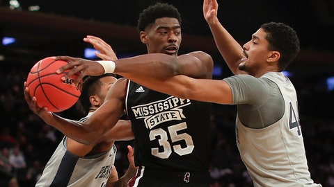 Penn State forward Julian Moore (44) tries to strip the ball from Mississippi State forward Aric Holman (35) in the second half of an NCAA college basketball game in the semifinals of the NIT, Tuesday, March 27, 2018, in New York. Penn State won 75-60. (AP Photo/Julie Jacobson)