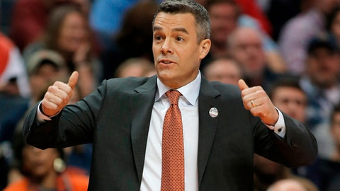 FILE - In this March 16, 2018, file photo, Virginia coach Tony Bennett signals for a jump ball during the first half of the team's first-round game against UMBC in a men's college basketball tournament in Charlotte, N.C. Bennett was named The Associated Press NCAA college basketball Coach of the Year, Thursday, March 29, 2018. (AP Photo/Bob Leverone, File)