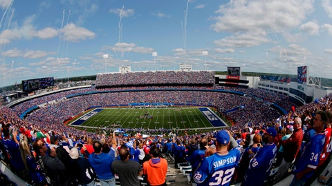 FILE - In this Sept. 10, 2017, file photo, fans stand for the playing of the National Anthem at New Era Stadium before an NFL football game between the Buffalo Bills and the New York Jets, in Orchard Park, N.Y. The Buffalo Bills' long-term future in Western New York was secured when Terry and Kim Pegula purchased the franchise following the death of Hall of Fame owner Ralph Wilson in October 2014. Where the team will play its home games _ at its current stadium in suburban Orchard Park, or at a new downtown Buffalo facility _ within the next decade is the question now inching to the forefront.(AP Photo/Frank Franklin II, File)
