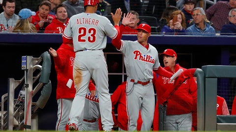 Philadelphia Phillies Aaron Altherr (23) celebrates scoring a run with manager Gabe Kapler in the sixth inning of a baseball game against the Atlanta Braves, Friday, March 30, 2018, in Atlanta. (AP Photo/Todd Kirkland)