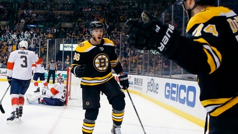Boston Bruins' Jake DeBrusk (74) celebrates his goal with Kevan Miller (86) during the second period of an NHL hockey game against the Florida Panthers in Boston, Saturday, March 31, 2018. (AP Photo/Michael Dwyer)