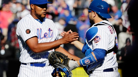 New York Mets relief pitcher Jeurys Familia, left, celebrates with catcher Travis d'Arnaud after the Mets defeated the St. Louis Cardinals 6-2 in a baseball game, Saturday, March 31, 2018, in New York. (AP Photo/Frank Franklin II)