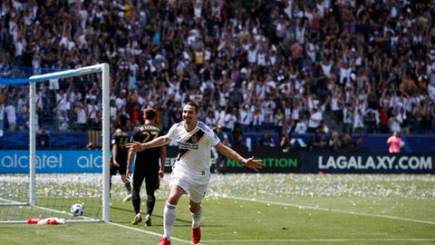 Los Angeles Galaxy's Zlatan Ibrahimovic, of Sweden, celebrates his second goal of the game during the second half of an MLS soccer match against the Los Angeles FC Saturday, March 31, 2018, in Carson, Calif. The Galaxy won 4-3. (AP Photo/Jae C. Hong)