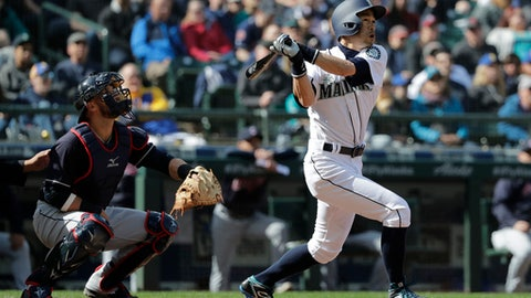 Seattle Mariners' Ichiro Suzuki, right, and Cleveland Indians catcher Yan Gomes watch as Suzuki flies out to right during the fifth inning of a baseball game, Saturday, March 31, 2018, in Seattle. (AP Photo/Ted S. Warren)