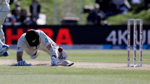 New Zealand's BJ Watling dives to make his ground while batting during play on day three of the second cricket test against England at Hagley Oval in Christchurch, New Zealand, Sunday, April 1, 2018. (AP Photo/Mark Baker)