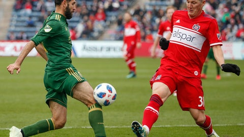 Portland Timbers midfielder Diego Valeri, left, battles for the ball with Chicago Fire midfielder Bastian Schweinsteiger, right, during the first half of an MLS soccer match, Saturday, March 31, 2018, in Bridgeview, Ill. (AP Photo/Kamil Krzaczynski)