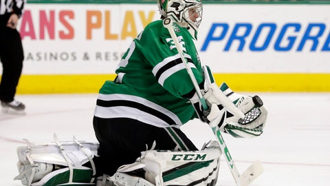 Dallas Stars goalie Kari Lehtonen (32) gloves a shot from the Minnesota Wild in the second period of an NHL hockey game in Dallas, Saturday, March 31, 2018. (AP Photo/Tony Gutierrez)