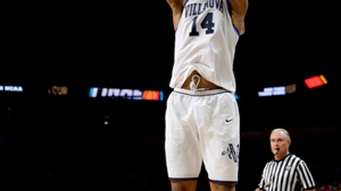 Villanova's Omari Spellman (14) shoots a 3-point basket against Kansas during the second half in the semifinals of the Final Four NCAA college basketball tournament, Saturday, March 31, 2018, in San Antonio. (AP Photo/David J. Phillip)