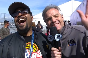 Kenny Wallace talks with Ice Cube before the race in California