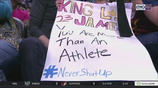 LeBron James gives armband to young fan with #NeverShutUp sign