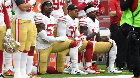Dec 10, 2017; Houston, TX, USA; San Francisco 49ers outside linebacker Eli Harold (57), strong safety Eric Reid (35), and wide receiver Marquise Goodwin (11) kneel for the national anthem prior to the game against the Houston Texans at NRG Stadium. Mandatory Credit: Shanna Lockwood-USA TODAY Sports