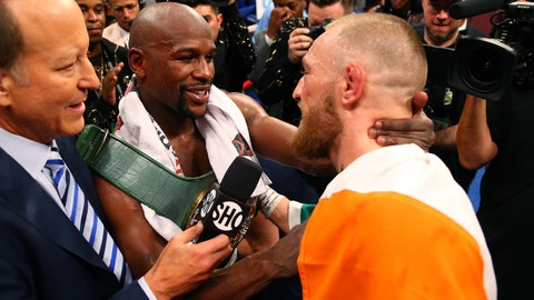 Aug 26, 2017; Las Vegas, NV, USA; Floyd Mayweather Jr. (left) embraces Conor McGregor following their boxing match at T-Mobile Arena. Mandatory Credit: Mark J. Rebilas-USA TODAY Sports