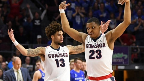 March 6, 2018; Las Vegas, NV, USA; Gonzaga Bulldogs guard Josh Perkins (13) and guard Zach Norvell Jr. (23) celebrate against the BYU Cougars during the first half in the championship game of the West Coast Conference tournament at Orleans Arena. Mandatory Credit: Kyle Terada-USA TODAY Sports