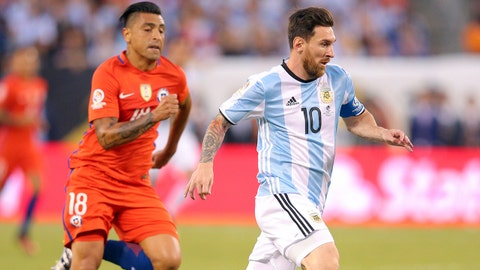 Jun 26, 2016; East Rutherford, NJ, USA; Argentina midfielder Lionel Messi (10) plays the ball against Chile defender Gonzalo Jara (18) during the championship match of the 2016 Copa America Centenario soccer tournament at MetLife Stadium. Chile defeated Argentina 0-0 (4-2). Mandatory Credit: Brad Penner-USA TODAY Sports