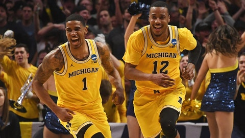 Mar 22, 2018; Los Angeles, CA, USA; Michigan Wolverines guard Muhammad-Ali Abdur-Rahkman (12) and guard Charles Matthews (1) celebrate after defeating the Texas A&M Aggies in the semifinals of the West regional of the 2018 NCAA Tournament at STAPLES Center. Mandatory Credit: Richard Mackson-USA TODAY Sports
