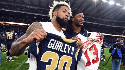 Oct 23, 2016; London, United Kingdom; New York Giants receiver Odell Beckham Jr. (left) poses with Los Angeles Rams running back Todd Gurley after exchanging jerseys during game 16 of the NFL International Series at Twickenham Statdium. The Giants defeated the Rams 17-10. Mandatory Credit: Kirby Lee-USA TODAY Sports