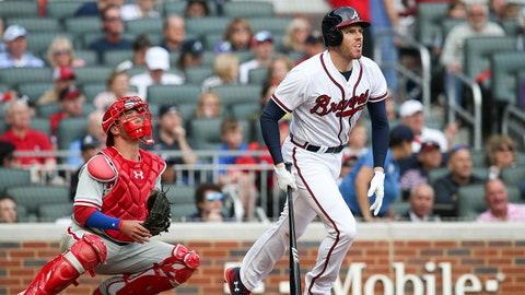 Mar 29, 2018; Atlanta, GA, USA; Atlanta Braves first baseman Freddie Freeman (5) hits a home run as Philadelphia Phillies catcher Andrew Knapp (15) looks on in the sixth inning at SunTrust Park. Mandatory Credit: Brett Davis-USA TODAY Sports