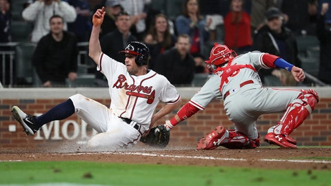 Mar 30, 2018; Atlanta, GA, USA; Atlanta Braves center fielder Peter Bourjos (12) is tagged out at home by Philadelphia Phillies catcher Andrew Knapp (15) during the eighth inning at SunTrust Park. Mandatory Credit: Jason Getz-USA TODAY Sports
