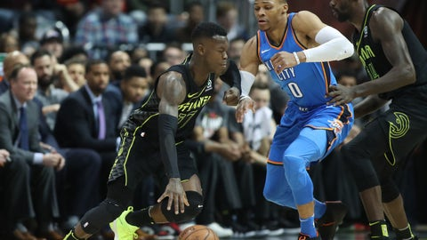 Mar 13, 2018; Atlanta, GA, USA; Atlanta Hawks guard Dennis Schroder (17) drives against Oklahoma City Thunder guard Russell Westbrook (0) during the first quarter at Philips Arena. Mandatory Credit: Jason Getz-USA TODAY Sports