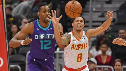 Mar 15, 2018; Atlanta, GA, USA; Atlanta Hawks guard Damion Lee (8) and Charlotte Hornets center Dwight Howard (12) battle for the ball during the second half at Philips Arena. Mandatory Credit: Dale Zanine-USA TODAY Sports