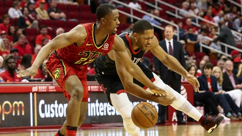 Mar 25, 2018; Houston, TX, USA; Atlanta Hawks guard Isaiah Taylor (22) attempts to steal a pass from Houston Rockets guard Eric Gordon (10) during the third quarter at Toyota Center. Mandatory Credit: Troy Taormina-USA TODAY Sports