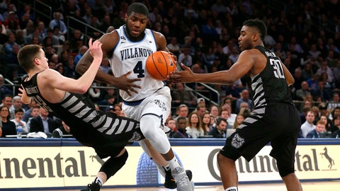 Mar 9, 2018; New York, NY, USA; Villanova Wildcats forward Eric Paschall (4) drives to the basket against Butler Bulldogs guard Sean McDermott (22) and forward Kelan Martin (30)during first half of Big East Conference Tournament semifinals game at Madison Square Garden. Mandatory Credit: Noah K. Murray-USA TODAY Sports
