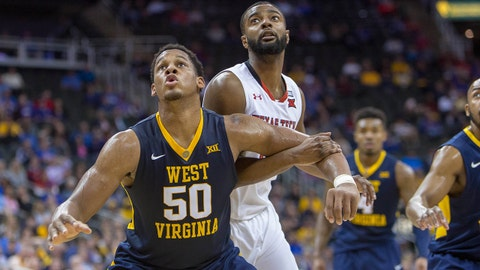 Mar 9, 2018; Kansas City, MO, United States; West Virginia Mountaineers forward Sagaba Konate (50) blocks out Texas Tech Red Raiders guard Niem Stevenson (10) during the 2nd half of the Big 12 tournament semifinal game at Sprint Center. Mandatory Credit: William Purnell-USA TODAY Sports