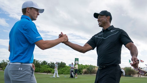 November 28, 2017; New Providence, The Bahamas; Jordan Spieth (left) shakes hands with Tiger Woods (right) on the driving range during Tuesday's practice round of the Hero World Challenge golf tournament at Albany. Mandatory Credit: Kyle Terada-USA TODAY Sports
