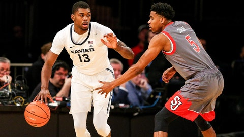 Mar 8, 2018; New York, NY, USA; Xavier Musketeers forward Naji Marshall (13) dribbles as St. John's Red Storm guard Justin Simon (5) defends during the first half in the Big East Conference tournament at Madison Square Garden. Mandatory Credit: Vincent Carchietta-USA TODAY Sports