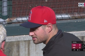 Eagles TE Brent Celek hanging out in Angels dugout while visiting Mike Trout
