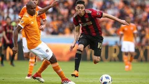Mar 3, 2018; Houston, TX, USA; Atlanta United midfielder Miguel Almiron (10) attempts to control the ball as Houston Dynamo defender Adolfo Machado (3) defends during the second half at BBVA Compass Stadium. Mandatory Credit: Troy Taormina-USA TODAY Sports