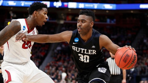 Mar 16, 2018; Detroit, MI, USA; Butler Bulldogs forward Kelan Martin (30) moves passed Arkansas Razorbacks forward Darious Hall (20) in the first half in the first round of the 2018 NCAA Tournament at Little Caesars Arena. Mandatory Credit: Raj Mehta-USA TODAY Sports