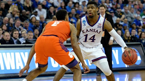 Mar 23, 2018; Omaha, NE, USA; Kansas Jayhawks guard Malik Newman (14) handles the ball against Clemson Tigers guard Marcquise Reed (2) during the second half in the semifinals of the Midwest regional of the 2018 NCAA Tournament at CenturyLink Center. Mandatory Credit: Steven Branscombe-USA TODAY Sports
