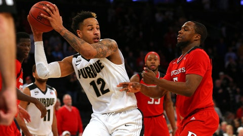 Mar 2, 2018; New York, NY, USA; Purdue Boilermakers forward Vincent Edwards (12) grabs a rebound against Rutgers Scarlet Knights guard Mike Williams (5) during the second half of a quarterfinal game of the 2018 Big Ten Conference tournament at Madison Square Garden. Mandatory Credit: Brad Penner-USA TODAY Sports